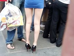 Really nice looking babe in blue miniskirt gets caught in this street candid voyeur video and it looks more than nice. Her legs are long and her butt
