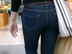 Candid ass in tight jeans and boots